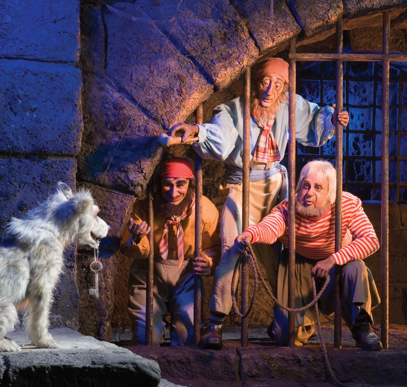 """NO ESCAPE -- In one of the """"Pirates of the Caribbean"""" attraction's most memorable scenes, a dog holds the keys - and the futures of some undesirables - in his mouth. This classic moment was recreated in Walt Disney Pictures' """"Pirates of the Caribbean:The Curse of the Black Pearl."""""""